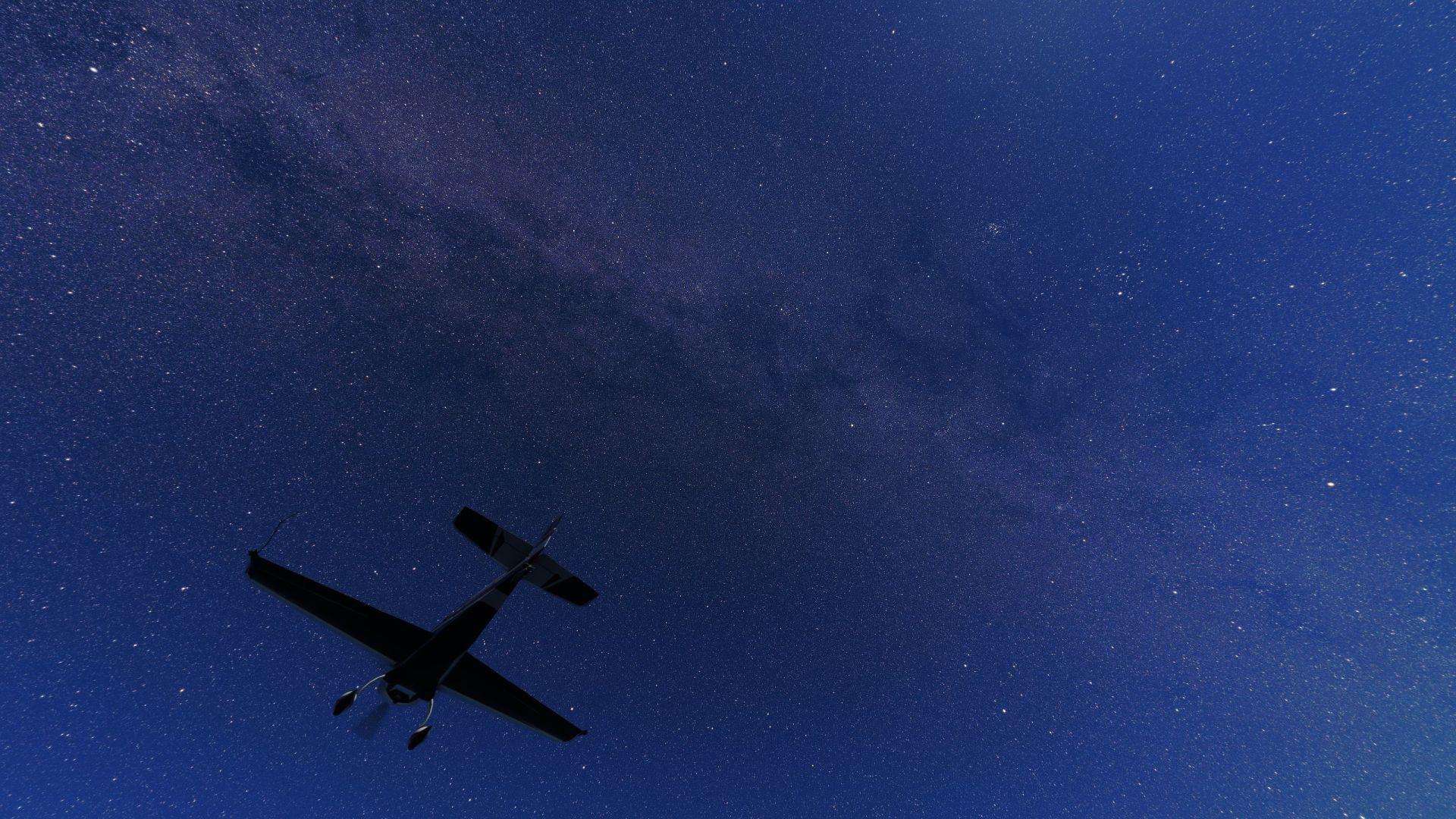 En Microsoft Flight Simulator, un avión vuela por debajo de la vía láctea