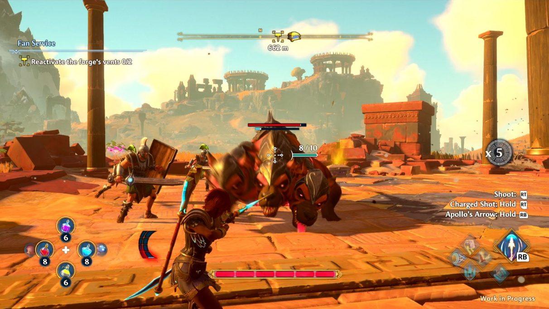 Una captura de pantalla de Immortals Fenyx Rising apuntando a un perro rojo gigante de tres cabezas.  Está cargando contra ella;  todas las cabezas se ven bastante enojadas.