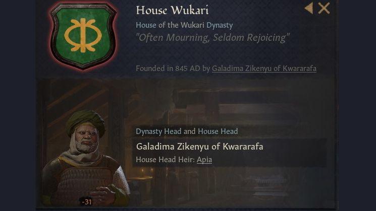 Un panel que muestra el escudo de la casa wukari, una especie de símbolo de un escudo de piel alto con lanzas cruzadas detrás, todo en amarillo, sobre un fondo verde.  En la foto aparece el líder de la casa y, de hecho, parece triste.