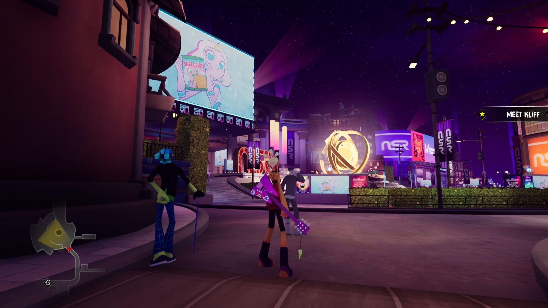Una captura de pantalla del área central de la ciudad en No Straight Roads.  Vinyl City es futurista, con muchas pantallas adicionales.  Hay una gran escultura dorada que se parece un poco a un átomo girando en el centro de una plaza abierta.