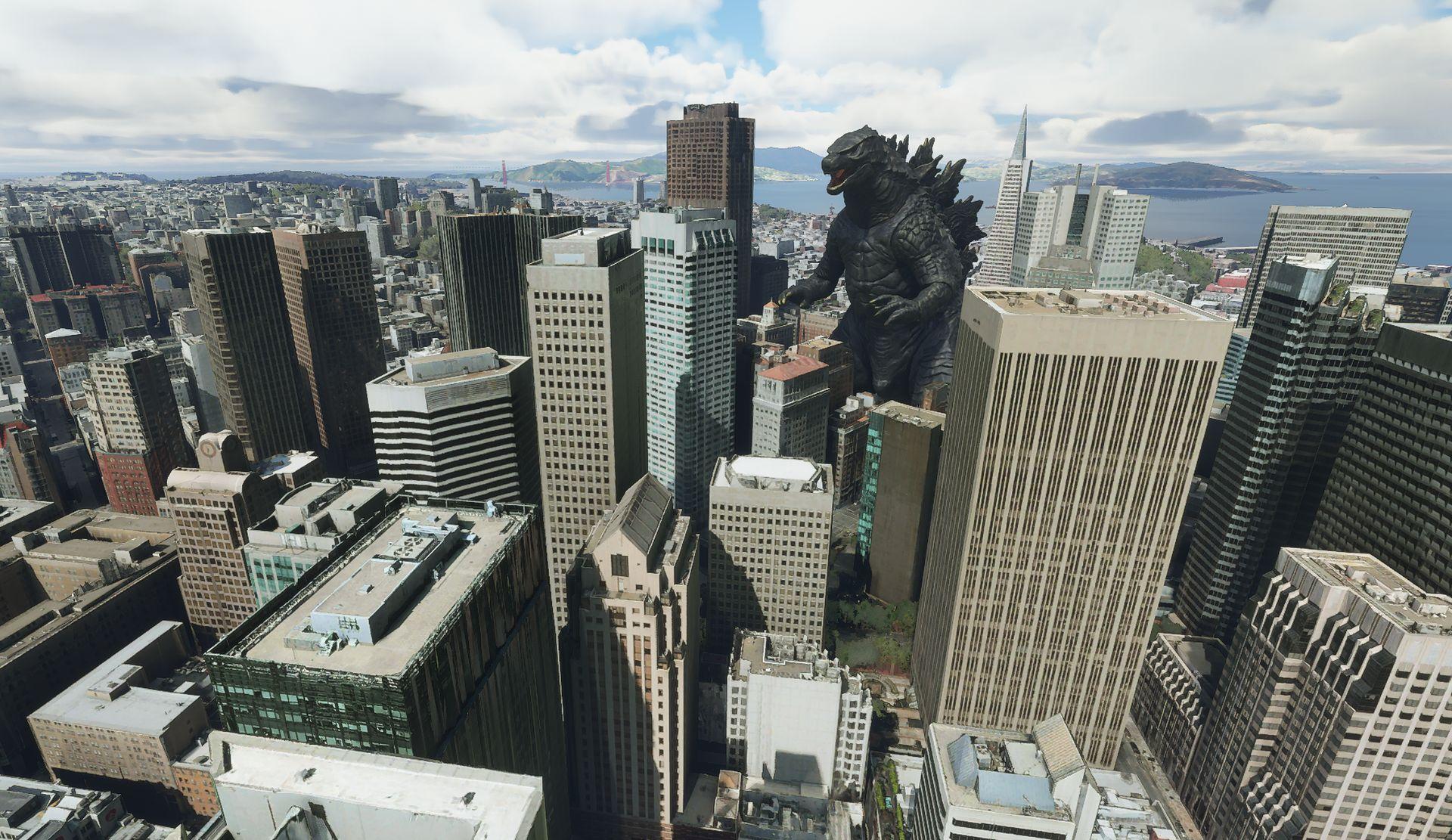 Una captura de pantalla de Microsoft Flight Simulator.  Muestra el horizonte de San Francisco, con una gran estatua de Godzilla del tamaño de un rascacielos en el medio.