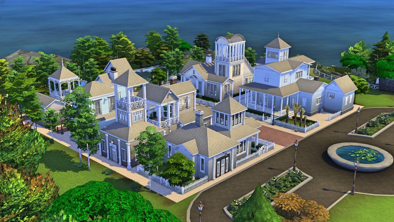 Una captura de pantalla de Simoniona que muestra el barrio de Truman de The Truman Show, construido en Los Sims 4: una calle suburbana brillante junto al mar con casas cubiertas de paneles blancos y estilos navales falsos.