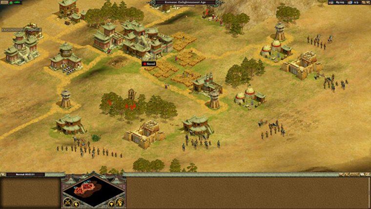Una captura de pantalla de una aldea en Rise Of Nations.