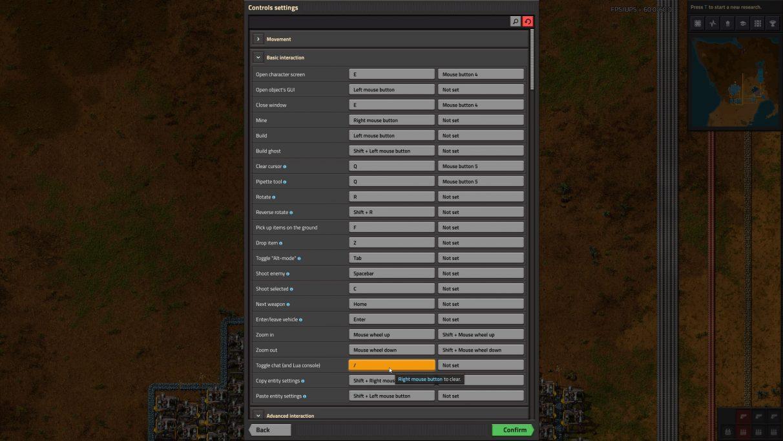 Puede encontrar la clave que abre la consola de Factorio en el menú Configuración.